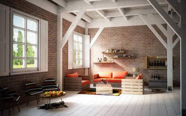 Salon lumineux et bien décoré avec mobilier canapé en palette bois
